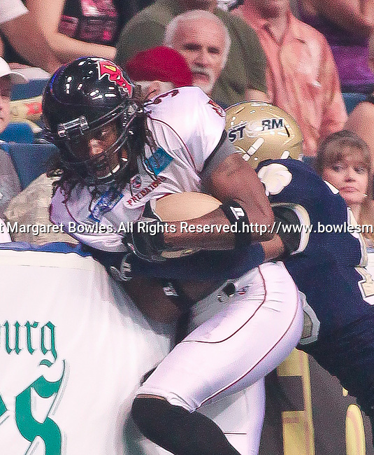 Aug 14, 2010: Orlando Predator wide receiver Bobby Sippio (#3) makes a touch catch against the wall. The Storm defeated the Predators 63-62 to win the division title at the St. Petersburg Times Forum in Tampa, Florida. (Mandatory Credit:  Margaret Bowles)