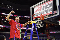 Washington, DC - MAR 11, 2018: Davidson Wildcats guard Kellan Grady (31) cuts down the net after winning the Atlantic 10 men's basketball championship between Davidson and Rhode Island at the Capital One Arena in Washington, DC. (Photo by Phil Peters/Media Images International)