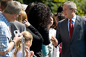 Washington, D.C. - October 1, 2006 -- United States President George W. Bush greets well-wishers upon his return to the White House from a stay at Camp David, Sunday, October 1, 2006, in Washington, DC.<br /> Credit: Chris Greenberg - Pool via CNP