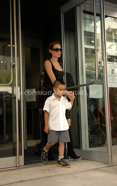 Angelina  Jolie picks up  Maddox   from   school  in   Manhattan  on   October  6,2007