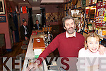 Breda and Declan Falvey serve.their joint agents Jim Burns (left) and.Billy OShea at Falveys Bar in Lower.Bridge Street.