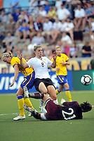 Amy Rodriguez scores opening goal...USWNT tied Sweden 1-1 at Morison Stadium, Nebraska.