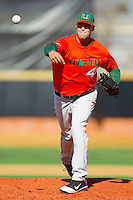 Starting pitcher E.J. Encinosa #44 of the Miami Hurricanes in action against the Wake Forest Demon Deacons at Gene Hooks Field on March 19, 2011 in Winston-Salem, North Carolina.  Photo by Brian Westerholt / Four Seam Images