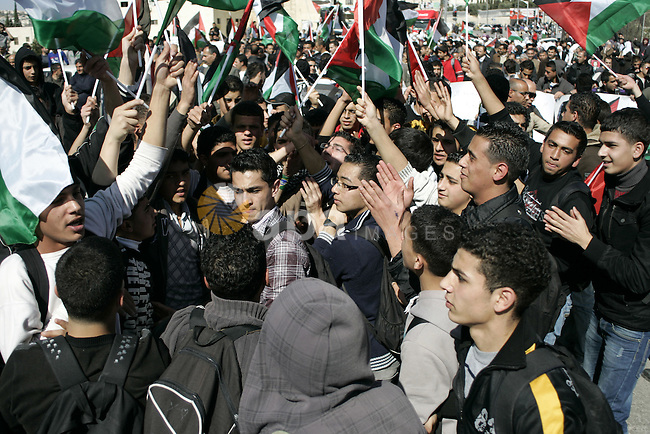 Palestinian protesters hold national flags and banners during a rally against the U.S. veto and calling for the national reconciliation in the West Bank city of Bethlehem, on Feb. 23, 2011. Photo by Najeh Hashlamoun