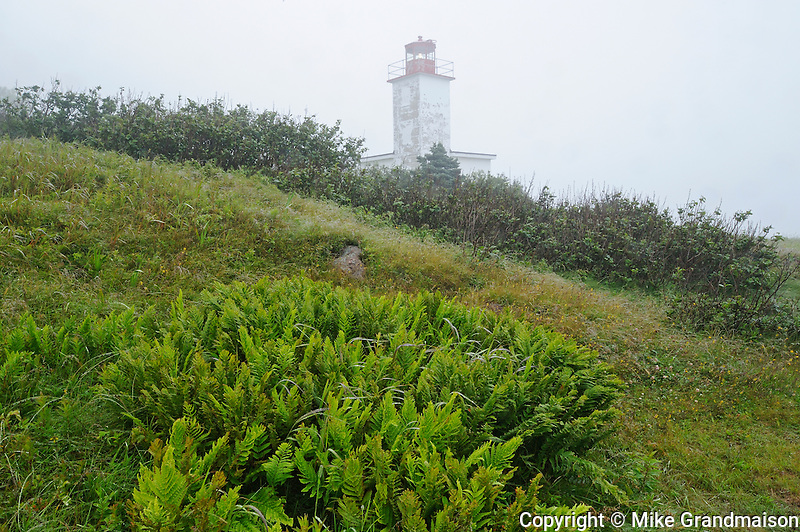 Quaco Head Lighthouse in fog<br /> <br /> Saint Martins<br /> New Brunswick<br /> Canada