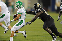 1 September 2011:  FIU's Gregory Hickman (55) tackles North Texas' Brelan CHancellor (80) in the second half as the FIU Golden Panthers defeated the University of North Texas, 41-16, at University Park Stadium in Miami, Florida.