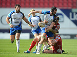 Connacht's John Muldoon spills the ball after being tackled by Scarlet's Emyr Phillips (headband) and Kristian Phillips<br /> <br /> Rugby - Scarlets V Connacht  - Rabodirect Pro12 - Sunday  30th March  2014 - Parc-y-Scarlets - Llanelli<br /> <br /> &copy; www.sportingwales.com- PLEASE CREDIT IAN COOK