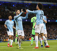 Manchester City's Bernardo Silva (left) acknowledges Leroy Sane after he set him up for his sides fifth goal<br /> <br /> Photographer Rich Linley/CameraSport<br /> <br /> UEFA Champions League Round of 16 Second Leg - Manchester City v FC Schalke 04 - Tuesday 12th March 2019 - The Etihad - Manchester<br />  <br /> World Copyright © 2018 CameraSport. All rights reserved. 43 Linden Ave. Countesthorpe. Leicester. England. LE8 5PG - Tel: +44 (0) 116 277 4147 - admin@camerasport.com - www.camerasport.com