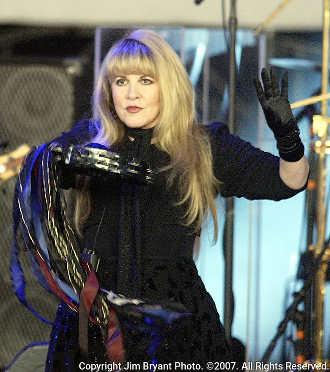 """Stevie Nicks belts out the lyrics to """"The Chain"""" during the Fleetood Mac performance at the White River Amphitheatre in Auburn, WA., on July  1, 2004.  This is the 25th stop of their 35 city nationwide 2004 tour. Jim Bryant Photo. ©2004. All Rights Reserved."""