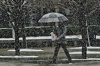 Snow falls as a man make their way in Jersey City during the season's first snow storm on December 10, 2013 in New York City Photo by Kena Betancur / VIEWpress.