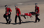 "Mcc0023074 . Daily Telegraph..A Grenadier Guard is taken off by stretcher bearers after ""piling in"" whist rehearsing on Horseguards for Trooping the Colour in celebration of the Queen's Birthday on June 12 ..The Grenadier Guards only recently finished a six month tour of Helmand , Afghanistan on March 31...London 19 June 2010......Not AP.Not Reuters.Not PA.Not Getty.Not AFP."