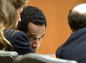 Convicted sniper John Allen Muhammad, center, leans over to talk to his attorney, Peter Greenspun, right, as Christie Leary listens during the penalty phase of his trial in courtroom 10 at the Virginia Beach Circuit Court in Virginia Beach, Virginia on November 18, 2003. John Muhammad was convicted of capital murder on November 17, 2003 for his role as organizer of a two-man sniper team that killed 10 people and terrorized the Washington, D.C. area in 2002. <br /> Credit: Dave Ellis - Pool via CNP