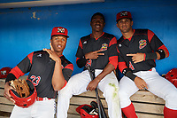 Batavia Muckdogs Terry Bennett (33), Thomas Jones (49) and J.C. Millan (4) in the dugout during a rain delay during a game against the West Virginia Black Bears on June 24, 2017 at Dwyer Stadium in Batavia, New York.  The game was suspended in the bottom of the third inning and completed on June 25th with West Virginia defeating Batavia 6-4.  (Mike Janes/Four Seam Images)