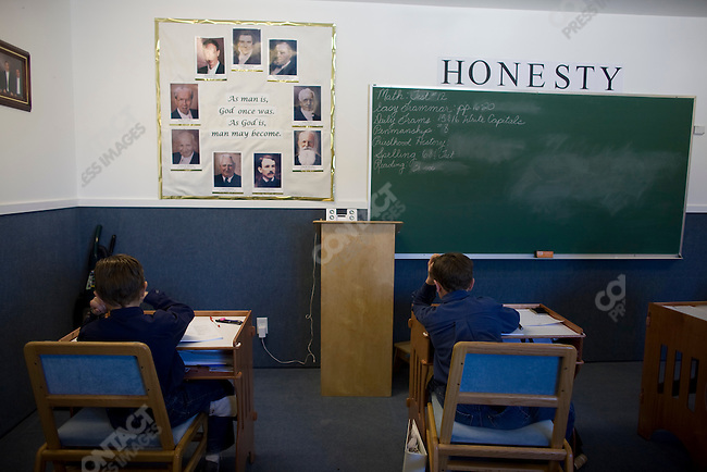 "Fundamentalist Mormon group F.L.D.S.,  school room with portraits of Church leaders on wall, ""Yearning for Zion"" compound in Eldorado, Texas, USA, February 11, 2009"