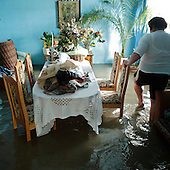 NOWY WIONCZENIN, POLAND, MAY 24, 2010:.Flooded house of Krystyna Ciastek..The latest chapter of disastrous floods in Poland has been opened yesterday, May 23, 2010, after Vistula river broke its banks and flooded over 25 villages causing evacualtion of most inhabitants..Photo by Piotr Malecki / Napo Images..NOWY WIONCZENIN, POLSKA, 24/05/2010:.Zatopiony dom Krystyny Ciastek.  Najnowszy akt straszliwych tegorocznych powodzi zostal rozpoczety wczoraj gdy Wisla przerwala waly na wysokosci wsi Swiniary kolo Plocka..Fot: Piotr Malecki / Napo Images ..