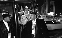 Police officer detective corporal Michael Jackson (right) stands guard as Miss California, Jennifer Jean, exits the beauties' bus outside the Genesis Convention Center on the final night of the Miss USA beauty pageant........