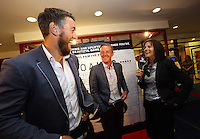 Pictured: Manager Garry Monk (C) shares a joke with rugby player Ryan Jones (L) while being interviewed. Sunday 14 September 2014<br />