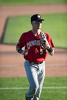 Vancouver Canadians right fielder Griffin Conine (9) jogs off the field between innings of a Northwest League game against the Spokane Indians at Avista Stadium on September 2, 2018 in Spokane, Washington. The Spokane Indians defeated the Vancouver Canadians by a score of 3-1. (Zachary Lucy/Four Seam Images)