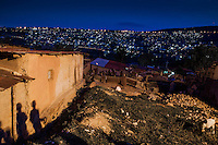I was born in Butare and we came to Kigali with my mother looking for a way to survive in the city. She wants to  find a way for us to live.<br /> In the evening I like watching the lights of the city. They come up before the stars. But I prefer the stars. I love watching the stars. They look different from different angles and they all have their own colors. <br /> And I like  the stars because I do believe that up in the sky there are other people or not people who live on planets near those stars.<br /> Jean D'Amour age 9. Photo by Brednan Bannon. Kigali Rwanda March 4 2014.
