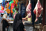 A Palestinian vendor sells meats at a market in Gaza City as the faithful prepare for the start of the Muslim holy fasting month of Ramadan on June 17, 2015. More than 1.5 billion Muslims around the world will mark the month, during which believers abstain from eating, drinking, smoking and having sex from dawn until sunset. Photo by Ashraf Amra