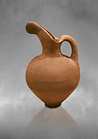 Hittite long neck beak spout pitcher. Hittite Old Period, 1650 - 1450 BC. Huseyindede. Çorum Archaeological Museum, Corum, Turkey. Against a grey bacground.