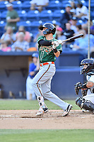 Greensboro Grasshoppers center fielder Zach Sullivan (27) swings at a pitch during a game against the Asheville Tourists at McCormick Field on May 10, 2018 in Asheville, North Carolina. The Tourists defeated the Grasshoppers 14-10. (Tony Farlow/Four Seam Images)