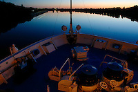 MS Yurij Andropov enters a lock on the Svir between lakes Onega and Ladoga, lit by the midnight sun.