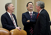 From left to right: United States Representative Andy Biggs (Republican of Arizona), US Representative John Ratcliffe (Republican of Texas) and US Representative Mark Meadows (Republican of North Carolina) laugh during a break as constitutional scholars testified before the US House Judiciary Committee in the Longworth House Office Building on Capitol Hill December 4, 2019 in Washington, DC. This is the first hearing held by the House Judiciary Committee in the impeachment inquiry against U.S. President Donald Trump, whom House Democrats say held back military aid for Ukraine while demanding it investigate his political rivals. The Judiciary Committee will decide whether to draft official articles of impeachment against President Trump to be voted on by the full House of Representatives. <br /> Credit: Drew Angerer / Pool via CNP