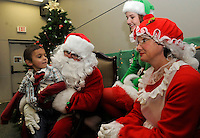 Note: Reissig is correct.<br /> STAFF PHOTO FLIP PUTTHOFF <br /> BREAKFAST WITH SANTA<br /> Raymond Coursey, age 4, chats with Santa on Saturday Dec. 6 2014 during the Breakfast with Santa event at the Rogers Public Library. Children and adults could visit Santa and enjoy donuts, craft-making and cartoons with a Christmas theme. The Santa family is Mike Johnson, from left, elf Emily Reissig and Mrs. Claus April Weimer.