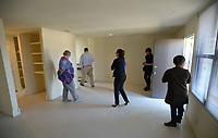 NWA Democrat-Gazette/ANDY SHUPE<br /> Deniece Smiley (right), Fayetteville Housing Authority director, leads a tour Friday, March 30, 2018, of Willow Heights a property that the authority directs, for the organization's board of directors and members of the public in Fayetteville. The board this year has to come up with a capital improvements plan, per U.S. Department of Housing and Urban Development regulations.