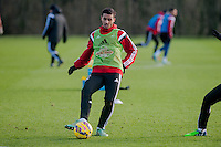 SWANSEA, WALES - JANUARY 28:  Kyle Naughton of Swansea City  plays the ball forwards  on January 28, 2015 in Swansea, Wales.