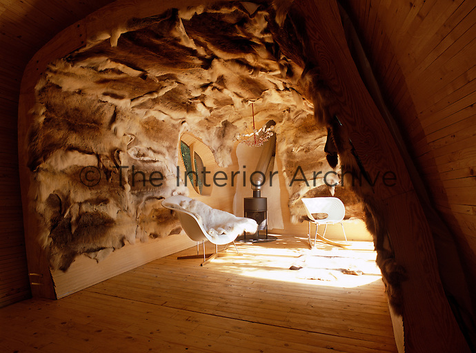 Animal skins stretched over birch lathes cover the walls of the living area and provide insulation in the cold winter months