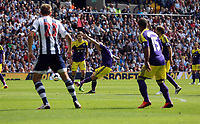 Pictured: Jonjo Shelvey of Swansea (C) takes a free kick off target. Sunday 01 September 2013<br />