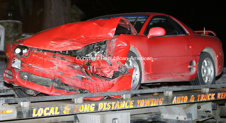 SOUTHBURY, CT 06 January 2005 -010605BZ03- This red Mitsubishi 3000GT was involved in a three car accident on Rte 172 near the Southbury Training School in Southbury on Friday.<br /> Jamison C. Bazinet Republican-American