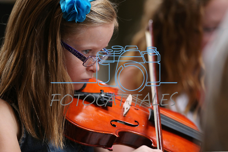 Esmay Harger, 11, performs at the Carson City Symphony's Youth Strings Summer Program concert in Carson City, Nev., on Thursday, July 27, 2017. <br /> Photo by Cathleen Allison