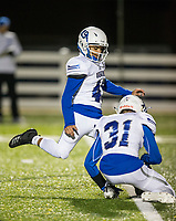 NWA Democrat-Gazette/BEN GOFF @NWABENGOFF<br /> Yahir Munoz, with Gavin Pitts holding, kicks an extra point for Rogers in the first quarter vs Springdale Har-Ber Friday, Nov. 1, 2019, at Wildcat Stadium in Springdale.