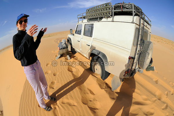 Africa, Mauritania, Sahara Desert. Recovering a stuck tourists Land Rover Defender TD5 Station Wagon out of the Sahara sand aside the desert piste from Nouadhibou to Choum. --- No releases available. Automotive trademarks are the property of the trademark holder, authorization may be needed for some uses.