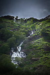 Cascading white water down a hillside in England in summer