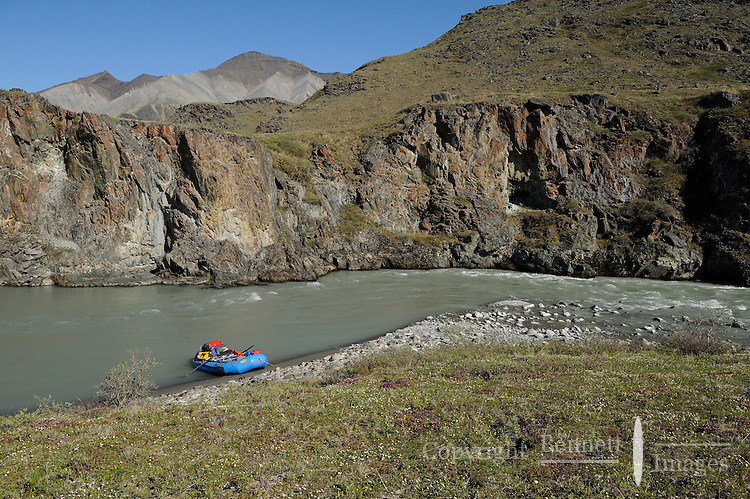 A raft is parked at the end of the the Hulahula River canyon  in Alaska's Arctic National Wildlife Refuge on a summer afternoon.