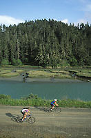 Bike riders riding on the Big River Hall Road, Mendocino California