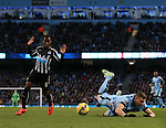 Vurnon Anita of Newcastle United brings down Edin Dzeko of Manchester City to concede a penalty - Barclays Premier League - Manchester City vs Newcastle Utd - Etihad Stadium - Manchester - England - 21st February 2015 - Picture Simon Bellis/Sportimage