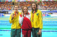 England's Francesca Halsall, centre, on the podium after winning women's 50m freestyle final.  Also pictured, bronze medalist Australia's Bronte Campbell, left, and silver medalist Cate Campbell<br /> <br /> Photographer Chris Vaughan/CameraSport<br /> <br /> 20th Commonwealth Games - Day 3 - Saturday 26th July 2014 - Swimming - Tollcross International Swimming Centre - Glasgow - UK<br /> <br /> © CameraSport - 43 Linden Ave. Countesthorpe. Leicester. England. LE8 5PG - Tel: +44 (0) 116 277 4147 - admin@camerasport.com - www.camerasport.com