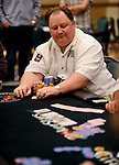 PS Team Pro Greg Raymer in a big pot, which he lost and was almost crippled.