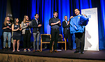Dr. Gabriel Esteban, president-elect of DePaul University, receives a jacket from members of the Student Government Association, including president Richard Popp, as they gathered Thursday, February 16, 2017, at the Student Center on the Lincoln Park Campus. Dr. Esteban was named the university's 12th president during a day of welcoming events at both the Loop and Lincoln Park Campuses. (DePaul University/Jamie Moncrief)