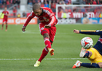 Toronto, Ontario - May 17, 2014: Toronto FC forward Jermain Defoe #18 scores a goal during the 1st half in  a game between the New York Red Bulls and Toronto FC at BMO Field.