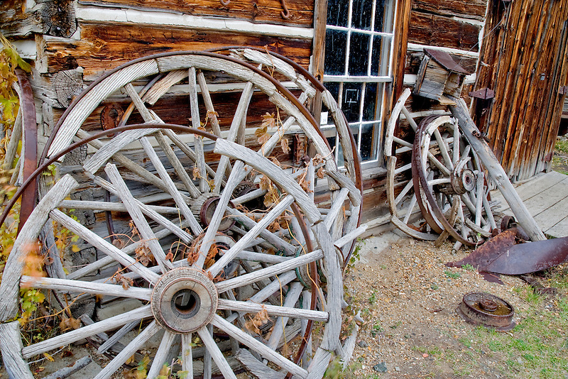 Old wagon wheels in from of house in Nevada city, Montana