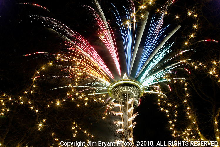 Seattle Space Needle with fireworks at New Years Eve. Jim Bryant Photo. ©2010. All Rights Reserved.
