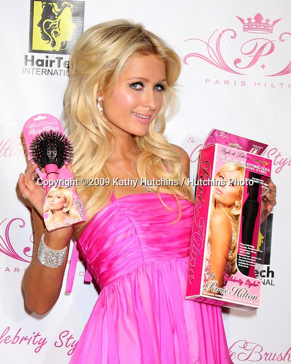 Paris Hilton & new product.arriving at the Paris Hilton Beauty Line Launch Party.Thompson Hotel.Beverly Hills,  CA.November 17, 2009.©2009 Kathy Hutchins / Hutchins Photo.