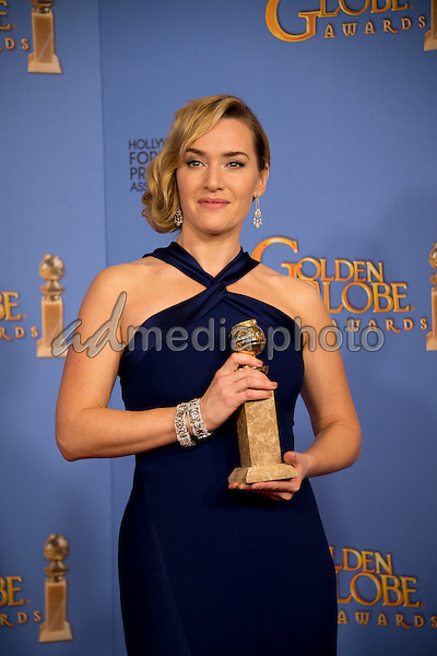 """After winning the category of BEST PERFORMANCE BY AN ACTRESS IN A SUPPORTING ROLE IN A MOTION PICTURE for her work in """"Steve Jobs,"""" actress Kate Winslet poses backstage in the press room with her Golden Globe Award at the 73rd Annual Golden Globe Awards at the Beverly Hilton in Beverly Hills, CA on Sunday, January 10, 2016. Photo Credit: HFPA/AdMedia"""
