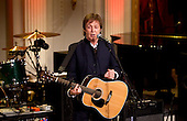 """Former Beatle Paul McCartney speaks before performing """"Michelle"""" during a concert in the East Room of the White House in Washington, D.C., U.S., on Wednesday, June 2, 2010. Obama presented McCartney with the Gershwin Prize for Popular Song awarded by the Library of Congress. .Credit: Andrew Harrer / Pool via CNP"""